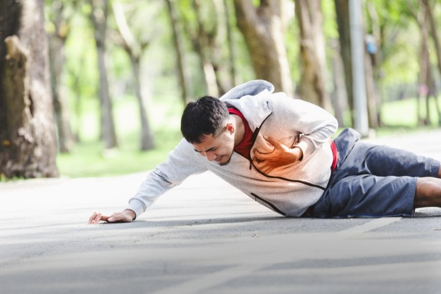 Young male runner collapsing with heart attack