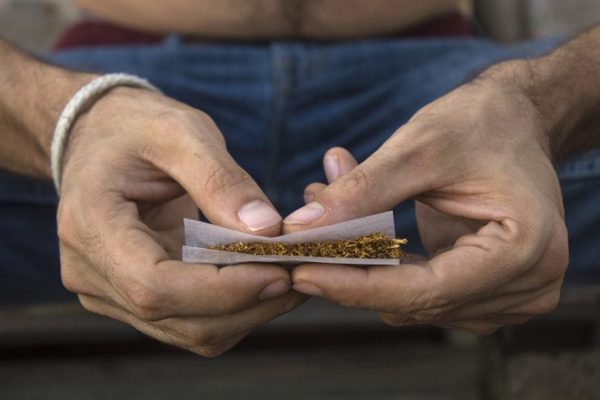 Man Rolling Joint Close up of hands